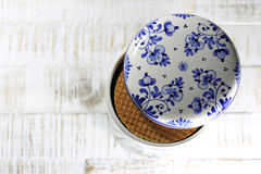 Dutch syrup waffles. Traditional Dutch syrup waffles in an original Delftware container on wooden background Royalty Free Stock Image