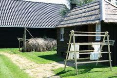 Dutch thatched barn and drying laundry Stock Photos
