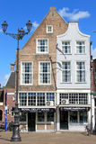Dutch touristic shop, Market Square, Delft. The dutch town of Delft is primarily known for its historic town centre and the Delft Blue pottery (Delftware) and Royalty Free Stock Images