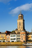 Dutch town Deventer with church. Tower at the river the IJssel Royalty Free Stock Image