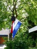 Dutch tradition school bag on flag when graduating Royalty Free Stock Photo