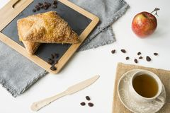 Dutch traditional cake appelflap, apple turnover,  with orange cup and saucer. with cup of tea royalty free stock image