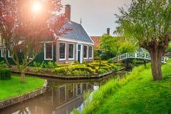 Dutch traditional house and bridge in Zaanse Schans village, Netherlands. Rural house with bridge, amazing sunrise in best touristic dutch village Zaanse Schans Stock Photos