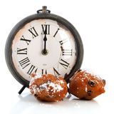 Dutch traditional oliebollen and clock Royalty Free Stock Photos