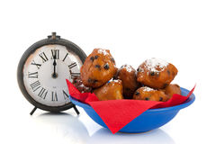 Dutch traditional oliebollen and clock Stock Image
