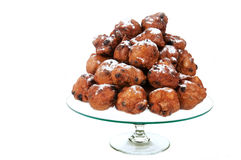 Dutch traditional oliebollen on glass-plate Stock Photo