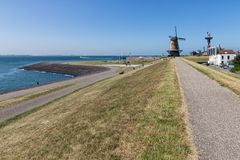 Free Dutch Traditional Windmill At Dike Near City Vlissingen Royalty Free Stock Images - 154886609