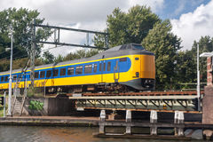 Dutch train crossing bridge Royalty Free Stock Photo