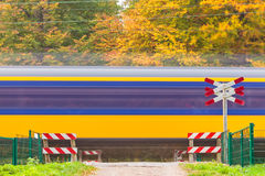 Dutch train passing a crossing Royalty Free Stock Photography