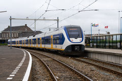 A Dutch train prepares to leave the Hook of Holland Station Royalty Free Stock Photos