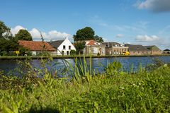 Free Dutch Typical Houses By The River Bank Royalty Free Stock Image - 104047696
