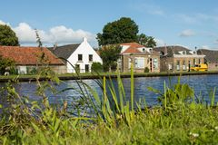 Free Dutch Typical Houses By The River Bank Stock Photos - 104047933