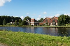 Free Dutch Typical Houses By The River Bank Royalty Free Stock Photos - 104048148