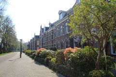 Dutch urban house for middle uper class with brick front and large garden. Dutch houses historic in the urban for middle uper class with brick front and large Royalty Free Stock Image
