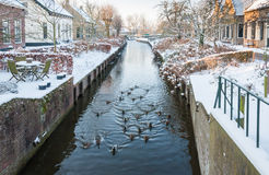 Dutch village canal in winter Stock Images