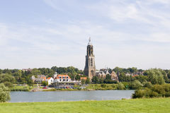 Dutch village with church on riverfront Stock Image