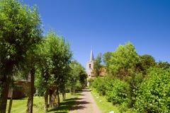 Dutch church. Dutch village with path to the church Stock Photos