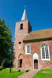 Dutch church. Dutch village with path to the church Stock Images