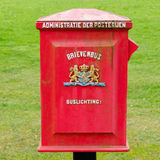 A Dutch vintage postbox. A Dutch old red metal postbox Stock Photo