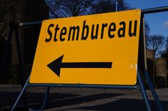 Dutch voting office sign. A Dutch sign pointing to a voting office Dutch: stembureau during elections stock photo