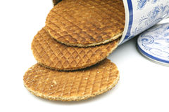 Dutch waffles in a colored can. Called a stroopwafel isolated on a white background Royalty Free Stock Image