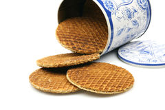 Dutch waffles in a colored can. Called a stroopwafel isolated on a white background Stock Image