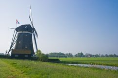 Dutch watermill in polder in spring Royalty Free Stock Images