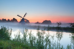 Dutch white windmill at sunrise Stock Photo