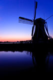 Dutch wind mill at a beautiful sunset Stock Image