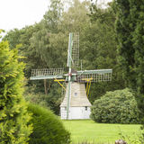 Dutch wind mill in forest scenery Royalty Free Stock Images