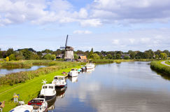 Dutch wind mill at river Stock Photography