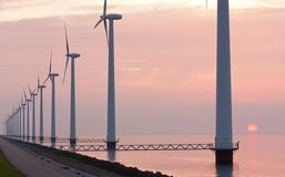 Dutch wind power under sunset along the coast Stock Image