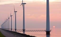 Dutch wind power under sunset along the coast Stock Image