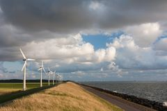 Dutch wind turbines and a cloudscape Royalty Free Stock Images