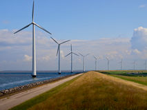 Dutch windfarm overview. Windfarm along the coast seen from the top of a dike Royalty Free Stock Photo