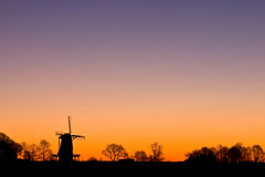Dutch windmil at sunrise Royalty Free Stock Image
