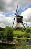 Dutch windmill. With cloudy sky Stock Photography