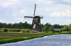 Dutch windmill. Near the water Stock Photography
