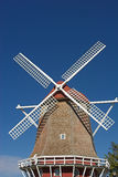Dutch Windmill 2. A vintage Dutch windmill with white blades Royalty Free Stock Photography