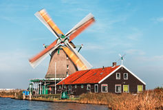 Dutch windmill. Image of a dutch windmill from Zaanse Schans, during a windy day with motion blur on the sails Stock Photography
