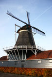 Dutch windmill. Traditional dutch old windmill with blue sky in the background Stock Photo