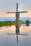 Dutch Windmill. In the quiet waters of early morning Stock Image