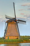 Dutch Windmill. One of the world famous Dutch windmills of Kinderdijk Stock Photos