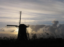 Dutch windmill 4. A Windmill at sunset in a Duthc landscape Royalty Free Stock Photo