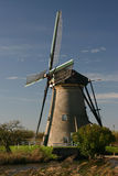Dutch Windmill. Sideview of a windmill on a canal in Kinderdijk, The Netherlands stock photos