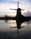 Dutch windmill 5. A windmill in a Dutch landscape, Kinderdijk royalty free stock image