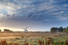 Dutch windmill and beautiful sunrise sky Royalty Free Stock Photos