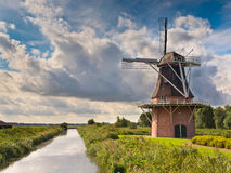 Dutch Windmill besides a Canal Stock Photos