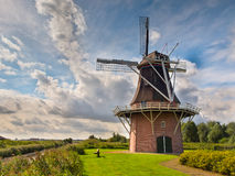 Dutch Windmill besides a Canal Royalty Free Stock Photo