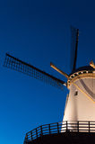Dutch windmill blue background Royalty Free Stock Photo